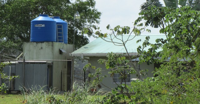 Roof top tanks store water in a Panamanian village without continuous water supply.