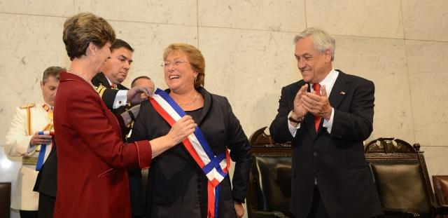 Isabel Allende swears in Michelet Bachelet as outgoing president Sebastián Piñera looks on.