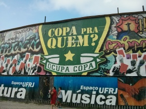 "Graffiti outside the Universidade Federal do Rio de Janeiro asks: ""Who's the Cup for?"""