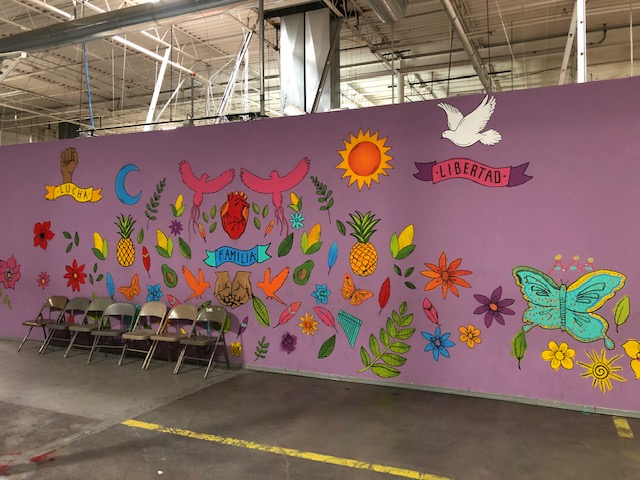 A mural painted in vibrant colors at a shelter for migrants in El Paso, Texas.