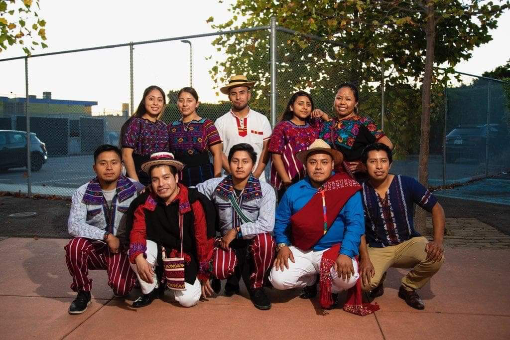 A group of friends from various Mayan cultures (Mam, K'iche', Ixil) after a performance at Urban Promise Academy Middle School in Oakland, California. (Photo courtesyofHenrySales).