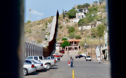 A photo taken through the Nogales wall, showing the town separated by the border.